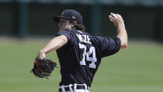 Detroit Tigers pitcher Casey Mize throws during baseball training camp, Monday, July 6, 2020, in Detroit.