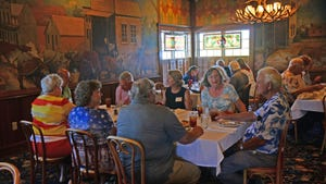 Visitors socialize inside the Brookville Hotel in June, 2015. The Brookville Hotel that was to reopen in June as Legacy Kansas may not be able to as the restaurant has about $160,000 with unpaid tax and penalties to Dickinson County.