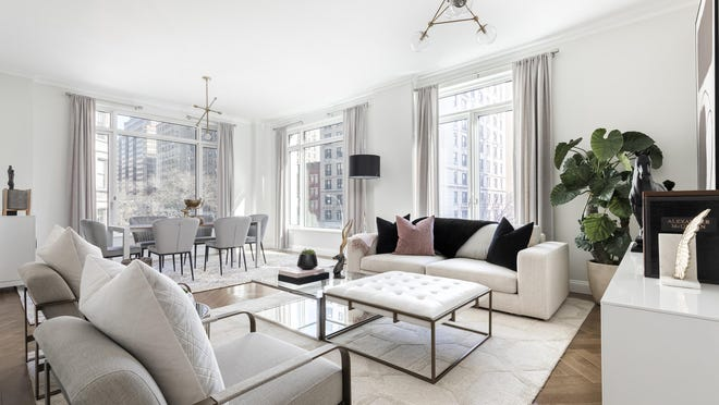 A living room space in need of two coffee tables is executed using a coffee table and ottoman of equal size. One table is glass to help to ensure a sense of openness and spaciousness.