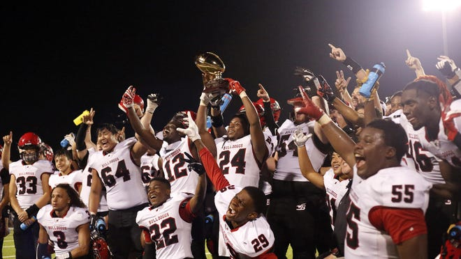 Winder-Barrow Bulldogs celebrate a win during a non-conference game between Winder-Barrow High School and Apalachee High School in Winder, Georgia, on Friday, Aug. 4, 2020. The Winder-Barrow Bulldogs won 33-27.
