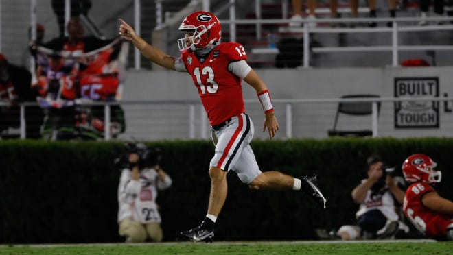 Georgia quarterback Stetson Bennett (13) celebrates during the game against Auburn at Dooley Field at Sanford Stadium on Saturday, Oct. 3, 2020.