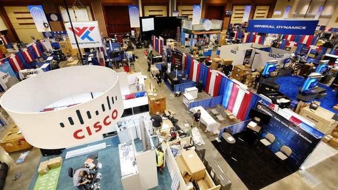 A file image shows vendors setting up booths at AFCEA International's TechNet trade show at the Augusta Convention Center. The annual show is one of the larger events held at the city-owned convention center.