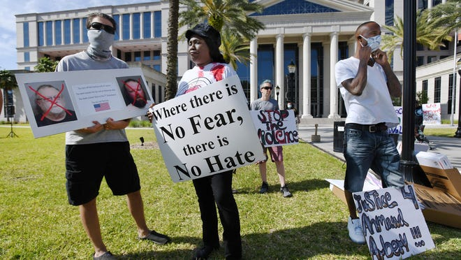 About 150 protesters showed up in front of the Duval County Courthouse in Jacksonville, Florida Friday, May 8, 2020 to protest the murder of Brunswick,Georgia resident Ahmaud Arbery who was shot and killed after being chased down by a father and son as Arbery was running through their neighborhood in February. Upon the release of a cell phone video shot by a friend of the suspects, the suspects were arrested on charges of felony murder and aggravated assault.