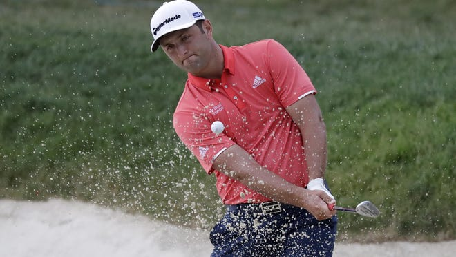 Jon Rahm, of Spain, hits from a bunker toward the 14th green during the final round of the Memorial Tournament on Sunday in Dublin, Ohio.