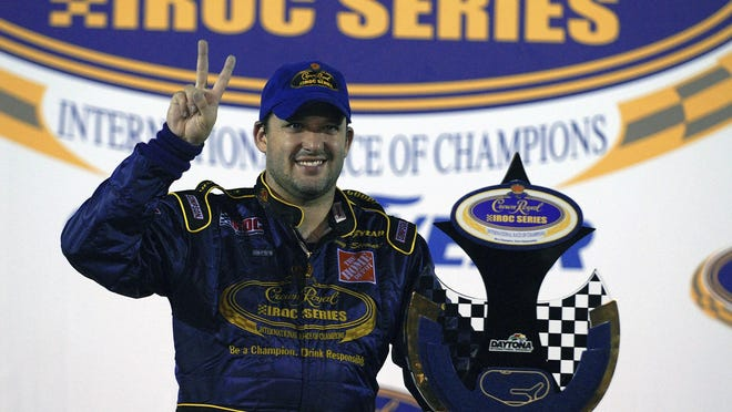 Tony Stewart poses with the trophy after winning  the Crown Royal IROC auto race in Daytona Beach, Florida on June 29, 2006.