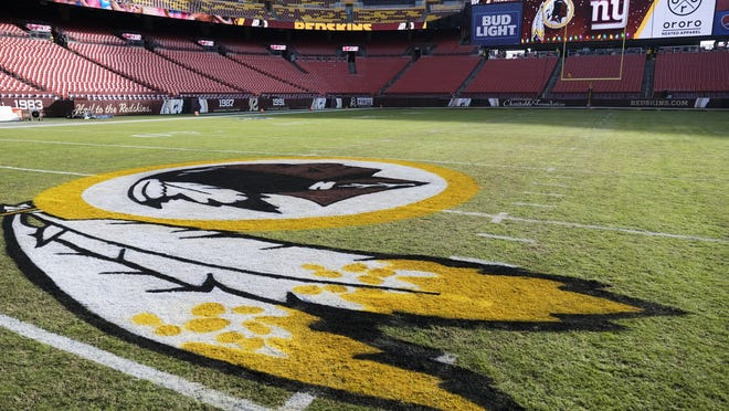 The Washington Redskins logo is seen on FedEx Field prior to an NFL game between the New York Giants and the Redskins on Dec. 22, 2019 in Landover, Md.