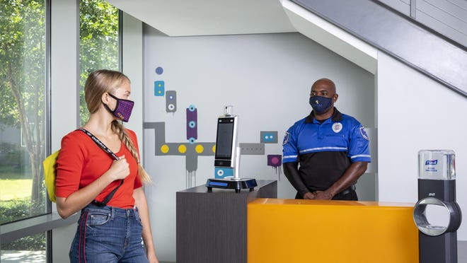 The Savannah College of Art and Design has implemented extra safety measures to keep students, faculty, and staff safe as they return to campus, including touchless temperature kiosks.