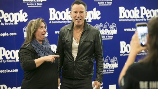 """A fan meets Bruce Springsteen at BookPeople in 2016. Thousands flocked to the bookstore to meet Springsteen and buy a signed copy of his autobiography """"Born To Run."""""""