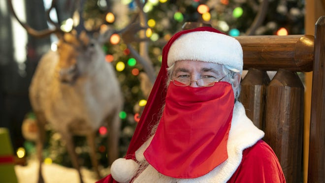 """Guy Benson works as the Santa Claus at Bass Pro Shops in Round Rock, seen here on Nov. 19. """"We're trying to do the best we can with the weird times we're having,"""" Benson says."""