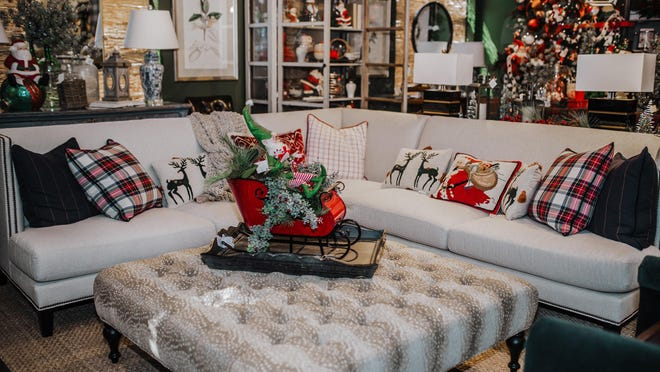 With Santa making an appearance in both figurine and needlepoint pillow form, he is sure to keep an eye on his busy team.