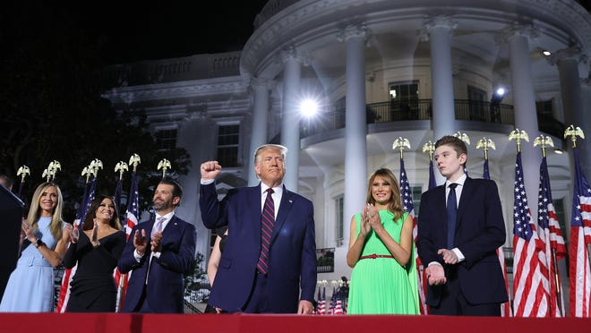 President Donald Trump, middle, reacts as he stands with his family members after delivering his acceptance speech for the Republican presidential nomination on the South Lawn of the White House on Thursday, Aug. 27, 2020, in Washington, D.C.