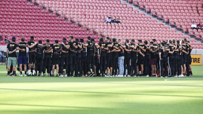 "Real Salt Lake and Los Angeles FC players gather for a group photo in Sandy, Utah, on Wednesday. After this was one of the games postponed, Salt Lake owner Dell Loy Hansen said the protests had ""taken a lot of wind out of"" his willingness to invest in the team."