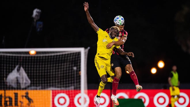 Columbus Crew forward Gyasi Zardes battles an Atlanta defender in the Crew's 1-0 win over Atlanta United in the group stage at the MLS is Back Tournament near Orlando, Florida.