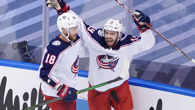 Liam Foudy, right, is congratulated by Blue Jackets teammate  Pierre-Luc Dubois after scoring a third-period goal Sunday against the Maple Leafs that game the Jackets a two-goal lead.