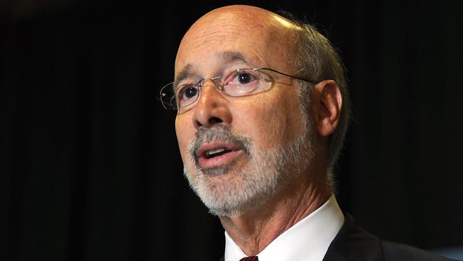 FILE- In this May 24, 2017, file photo, Pennsylvania Gov. Tom Wolf appears at an event in Erie, Pa. Wolf wants to use $145 million in a worker's compensation fund to help businesses cope with the coronavirus pandemic. His proposal would require a vote from the Republican-majority Legislature to appropriate the money, and there has been no deal struck to accomplish that. (Christopher Millette/Erie Times-News via AP, File)