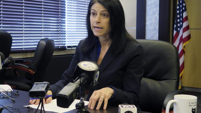 In this March 5, 2020, file photo, Michigan Attorney General Dana Nessel addresses the media during a news conference in Lansing, Mich. Democratic attorneys general in more than 20 states, including Nessel, sued Education Secretary Betsy DeVos on Wednesday, July 15, seeking to repeal her overhaul of a student loan forgiveness program.