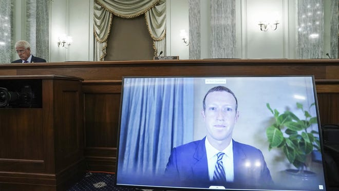 Facebook CEO Mark Zuckerberg appears on a screen as he speaks remotely during a hearing before the Senate Commerce Committee on Capitol Hill, Wednesday, Oct. 28, 2020, in Washington. The committee summoned the CEOs of Twitter, Facebook and Google to testify.