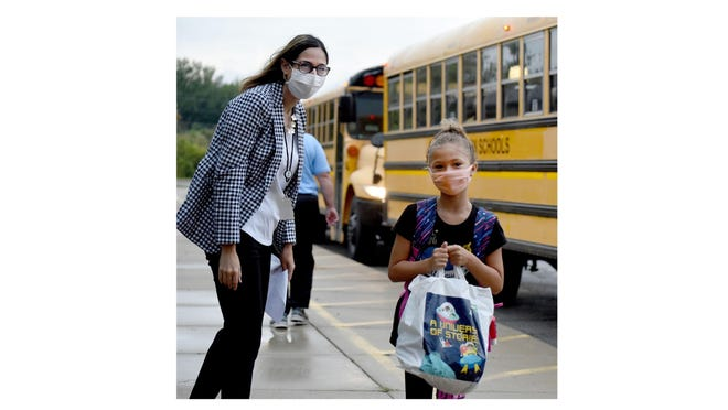 North Elementary School Principal Maria Mincher greets fourth-grader Nativida Collazo, 9, and several others on the first day of Jefferson Public Schools Tuesday.