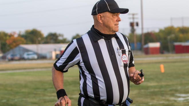 Referee Bill Gomoluch moves up the field during Friday's game between Monroe St. Mary Catholic Central and Flat Rock.