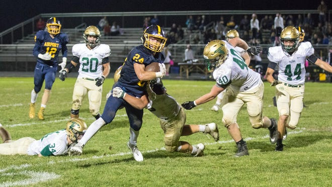 The SMCC defense led by Jace Worrell (34), Gus Flint (20), Mason Gullen (40), Jackson Strube (44) and John Ritchie close in on Airport's Bryce Bondy during a game in 2018. Because of the shortened schedule due to the COVID-19 pandemic, the two old rivals will not play each other in 20202.