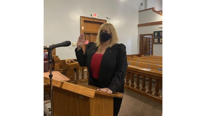 Annamarie Osment is sworn in as Monroe County Clerk/Register of Deeds. Circuit Judge Michael A. Weipert presided over the ceremony.