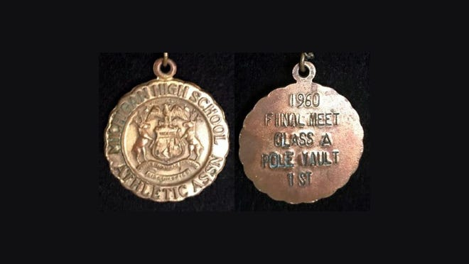 Nicholas (Mickey) Turcheck of Taylor got the state championship medal for the pole vault in 1960 after tying John Baidy of Monroe.