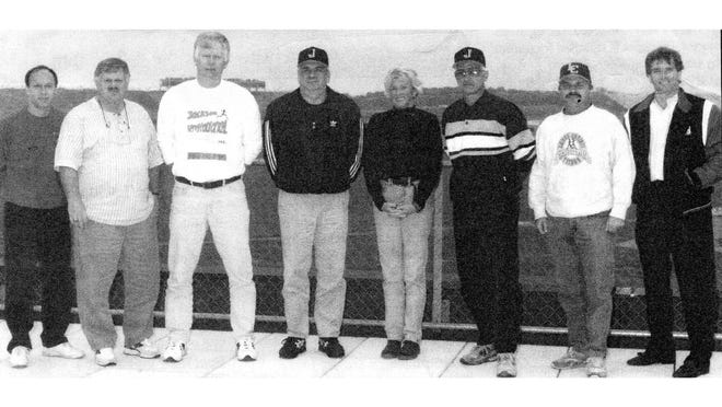 Dave Bork of Monroe High (second from left) was part of the organizing committee helped the Michigan High School Athletic Association set up the cross country state finals at Michigan International Speedway. The other committee members are (left to right) Barry Gibson of MIS, Wayne McDonald of Jackson Northwest, Jerry Reis of Jackson, Pat Richardson of Grass Lake, Chuck Janke of Jackson, Mike Woolsey of Jackson Lumen Christi and Tommy Cameron of MIS.