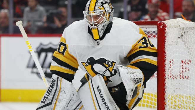 FILE - In this Jan. 17, 2020, file photo, Pittsburgh Penguins goaltender Matt Murray plays against the Detroit Red Wings in the second period of an NHL hockey game in Detroit. Murray says he's focusing on the NHL's return to play, not the potential economic ramifications on the league due to the COVID-19 pandemic.