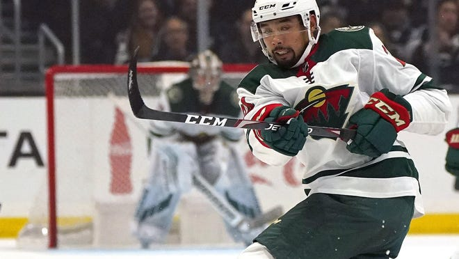 FILE - Minnesota Wild defenseman Matt Dumba passes the puck during the first period of an NHL hockey game against the Los Angeles Kings in Los Angeles, in this Saturday, March 7, 2020, file photo. Bonding between veterans and youngsters has been a time-honored tradition in hockey. But in yet another setback related to the relentless COVID-19, NHL protocols aiming to curb the virus spread and keep the schedule on track could make that vital off-ice development of camaraderie more difficult.