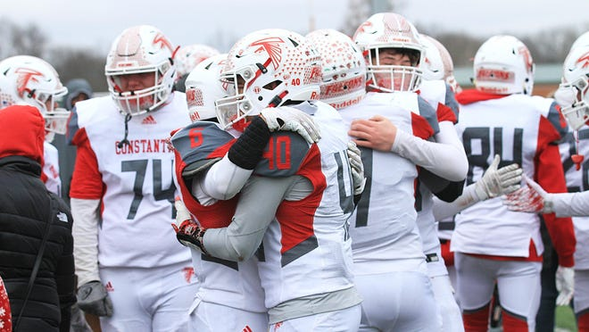 Constantine players share hugs following a semifinal loss to Clinton on Saturday.