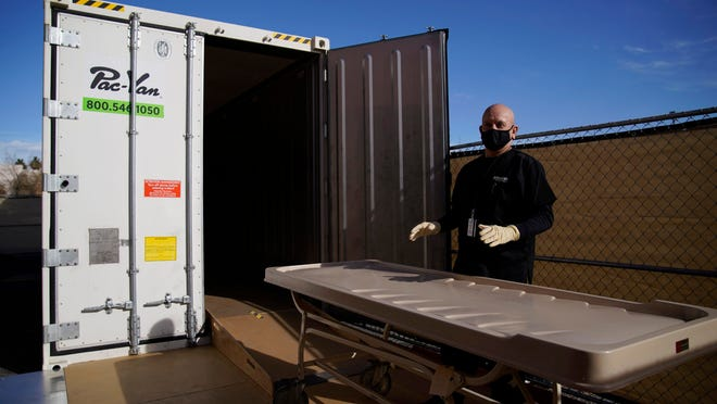 Michael Murphy, a consultant serving as interim Clark County coroner, gives a tour of a refrigerated trailer at the coroner's office in Las Vegas.