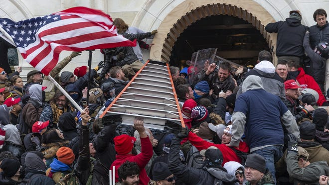 Rioters clash with police to enter the Capitol building Jan. 6 in Washington, D.C. Rioters broke windows and breached the building in an attempt to overthrow the results of the 2020 election.