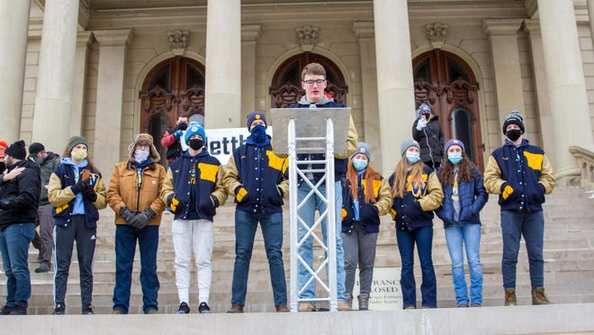 Whiteford Athlete Cole Giesige speaks to the crowd with support from fellow Whiteford students: (left to right) Zoe Bauman, Jake Giesige, Ryin Ruddy, Jack Andrews, Ava Hillard, Paige Thomas, Madelyn Thomas and Shea Ruddy at the #LetThemPlay rally in Lansing Saturday.