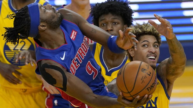 Detroit Pistons forward Jerami Grant (9) shoots against Golden State Warriors center James Wiseman, middle, and guard Kelly Oubre Jr. during the first half of an NBA basketball game in San Francisco, Saturday, Jan. 30, 2021.