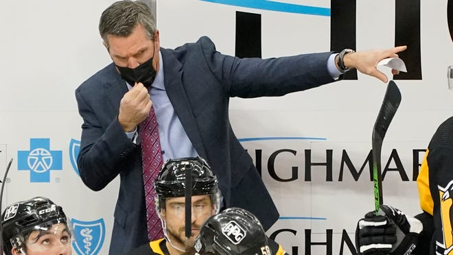 Pittsburgh Penguins head coach Mike Sullivan gives instructions during the third period of an NHL hockey game against the New York Rangers in Pittsburgh, Sunday, Jan. 24, 2021. The Penguins won 3-2. (AP Photo/Gene J. Puskar)