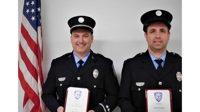Capt. Calvin Stump Jr. (left) and Firefighter Justin Winser were honored recently as Officer of the Year and Firefighter of the Year, respectively for the London-Maybee-Raisinville Volunteer Fire Department for 2020.
