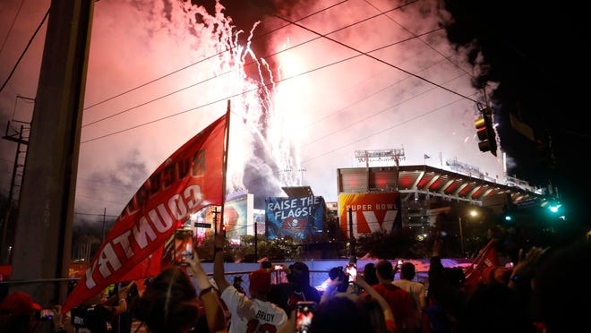 Tampa Bay Buccaneers fans celebrate after Super Bowl LV on Sunday in Tampa, Fla.