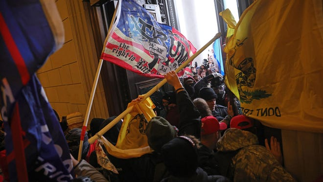 Protesters supporting U.S. President Donald Trump break into the U.S. Capitol on Wednesday, Jan. 6, 2021, in Washington, D.C. (Win McNamee/Getty Images/TNS)