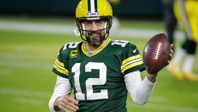 Aaron Rodgers warms up before a Chicago-Green Bay game in November 2020. The Pack went on to win its second consecutive NFC North divisional title, with a 13-3 record.