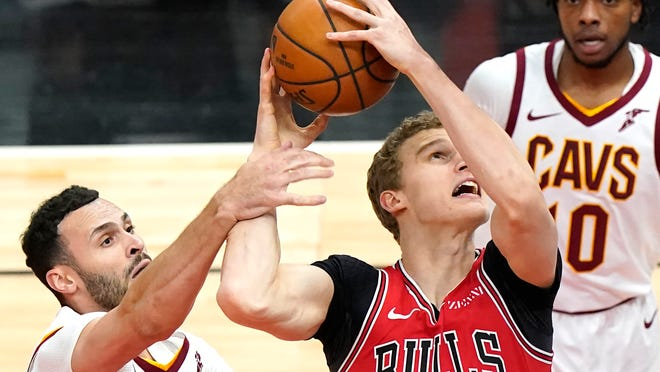 Chicago Bulls forward Lauri Markkanen, center, could give the Cavs the 3-point threat they need but losing forward Larry Nance Jr., left, leaves a big leadership hole on and off the court. [Nam Y. Huh/Associated Press]