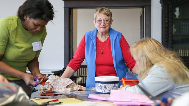 Instructor Joan Kellett, of Endicott, looks on while participants work during a freehand quilting instructional course held at Your Home Public Library on Monday. A stable tax, approved by voters in 2004, allows the library to offer a range of programming for children and adults.