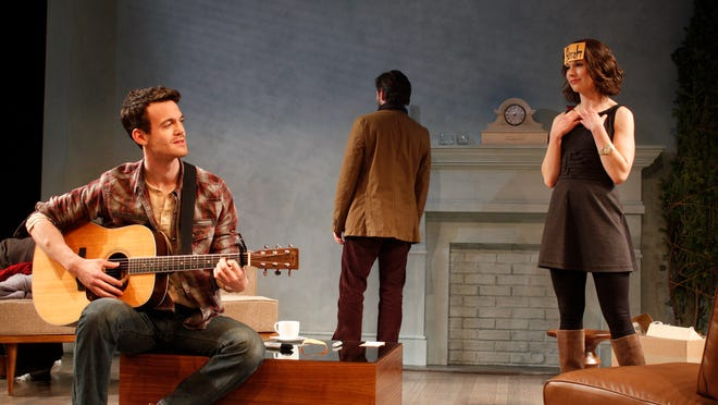 Sam (Ben Diskant, left) sings to his girlfriend Sarah (Janie Brookshire) as Sarah's best friend Nate (Karl Miller) wrestles with his emotions.