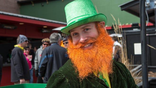 Jeremy Wilcox, 29, of Clive, sports a green hat and orange beard during the St. Patrick's Day party March 15, 2014, at Mickey's Irish Pub in downtown Des Moines.