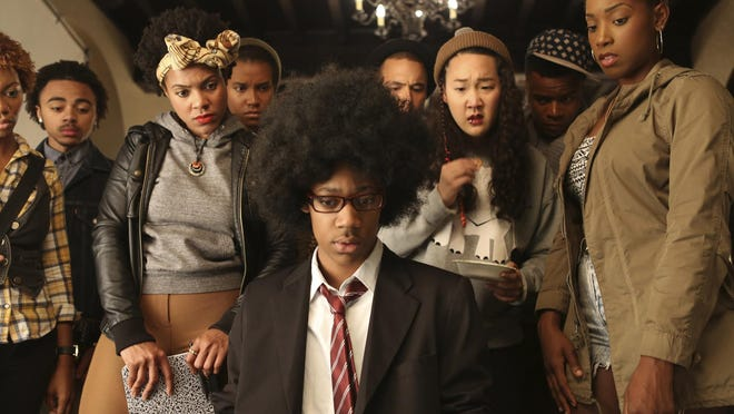 """Tyler James Williams, foreground, plays Lionel, a quiet, gay science-fiction buff, in """"Dear White People."""""""