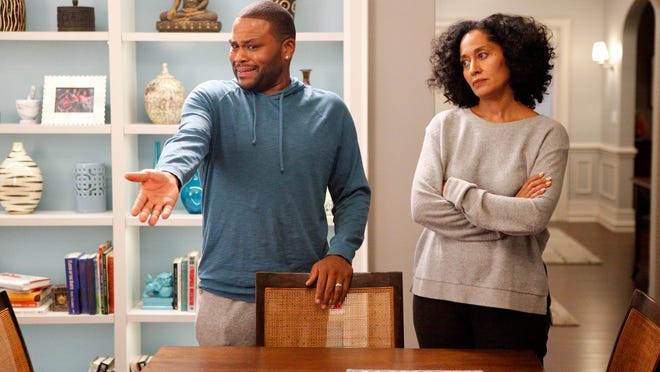 """Anthony Anderson and Tracee Ellis Ross appear in a scene from """"black-ish."""" The series was created by Kenya Barris, who was motivated to write the comedy about an African-American family's efforts to honor its heritage in part by the unreality of what he grew up watching on television."""