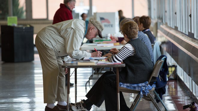 Ralph Kietzman gets ready to vote at Alberta Kimball Auditorium. Oshkosh residents voted in the spring election on Tuesday, April 7, 2015.