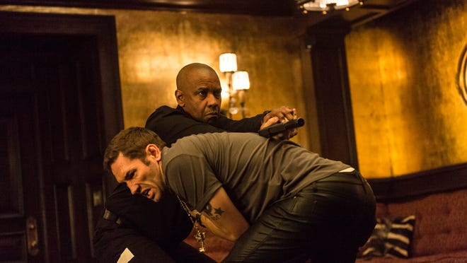 "Denzel Washington and Nash Edgerton struggle in a scene from ""The Equalizer."""