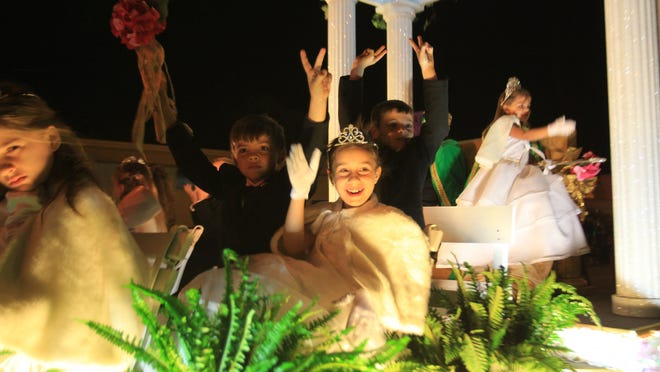 Kids wave from a float at last year's Edison Festival of Light Grand Parade.