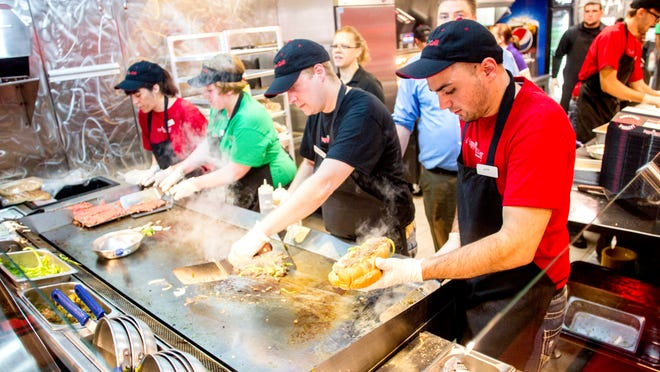 Austin Berger, right, prepares a steak sandwich at PepperJax Grill in downtown Iowa City, IA on Wednesday, May 28, 2014. The new sandwich shop opens today across from the Old Capitol Mall on Clinton Street.
