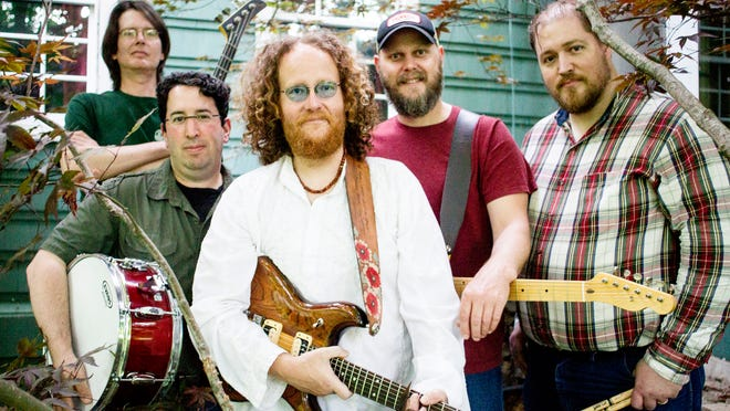 Members of the band Winterland (from left) David Lumberg, Joshua Weiner, Stacy Webster, Marc Janssen, and James Robinson pose for a photo outside Robinson's home in Iowa City, IA on Wednesday, May 28, 2014.